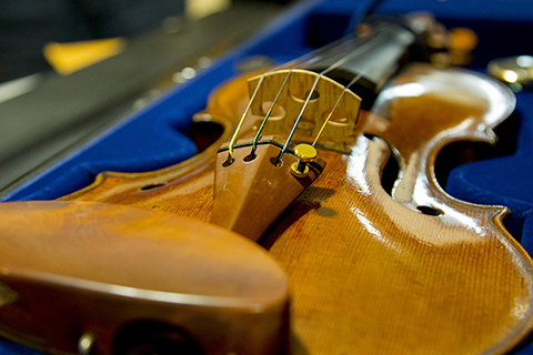 Sue Miller Violin sitting in an open carrying case lined in a blue colored lining